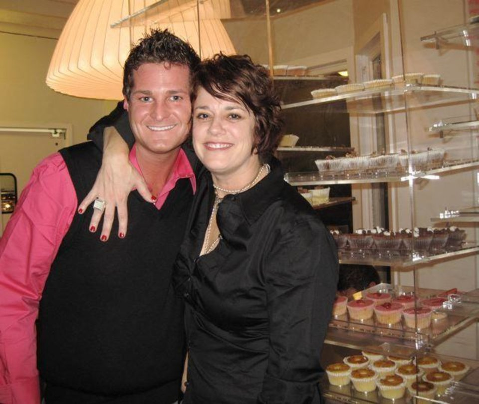 SARASARA CUPCAKE BAKERY......Randall Marsh and Toni Hoffman celebrate the grand opening of SaraSara Cupcake bakery. He is General Manager and she is Managing Partner. (Photo by Helen Ford Wallace).