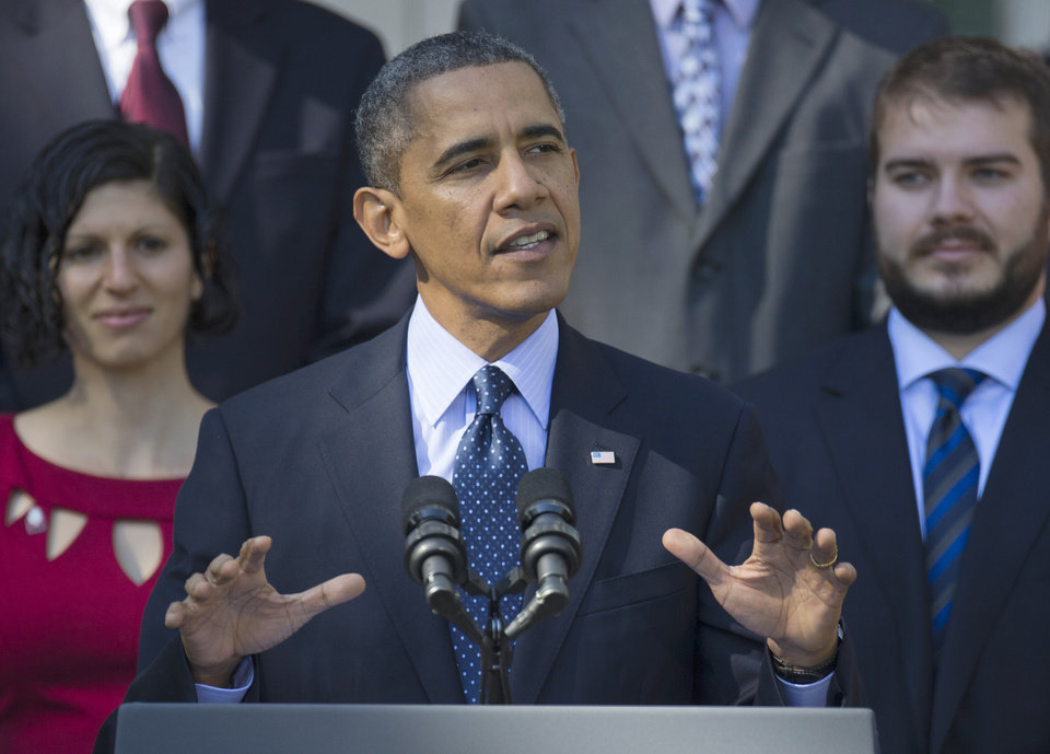Photo - President Barack Obama gestures while speaking in the Rose Garden of the White House in Washington, Monday, Oct. 21, 2013, on the initial rollout of the health care overhaul. Obama acknowledged that the widespread problems with his health care law's rollout are unacceptable, as the administration scrambles to fix the cascade of computer issues. (AP Photo/ Evan Vucci)
