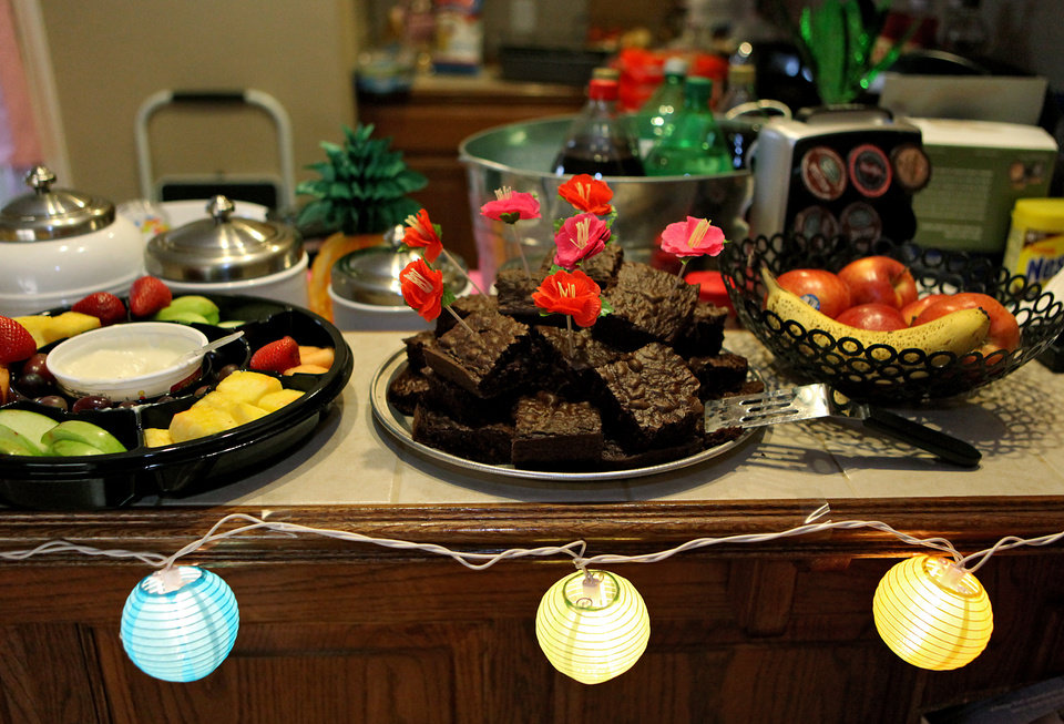 Photo - ALEX GATES: Island-themed decorations and food during a