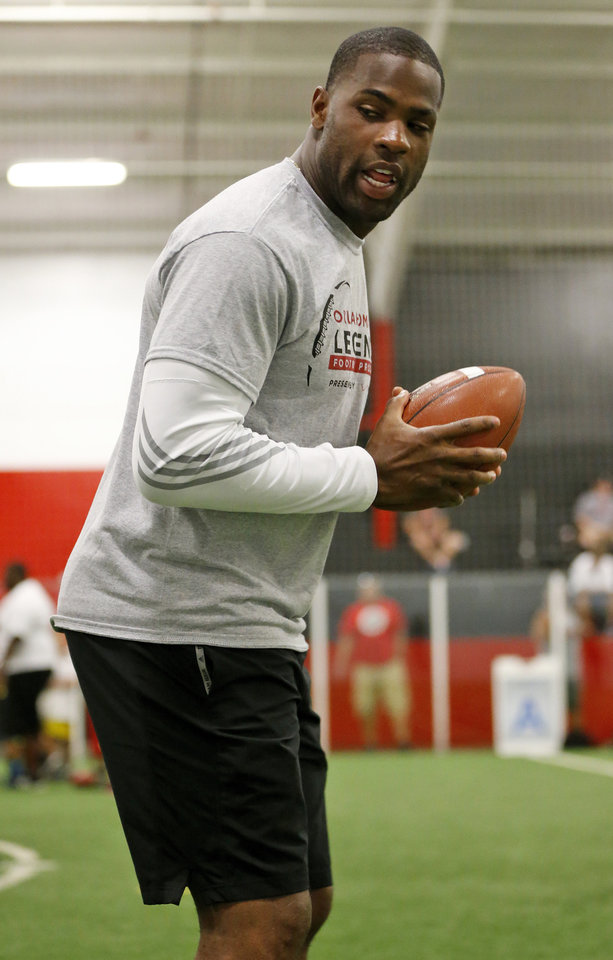 Photo - Former OU football player DeMarco Murray gives instructions during the Oklahoma Legends Football ProCamp at the Indoor Soccer Arena, 100 N. McCormick Ave., in Oklahoma City, Saturday, July 25, 2015. The youth football camp hosted children from the area Boys & Girls Clubs of Oklahoma County. Photo by Nate Billings, The Oklahoman