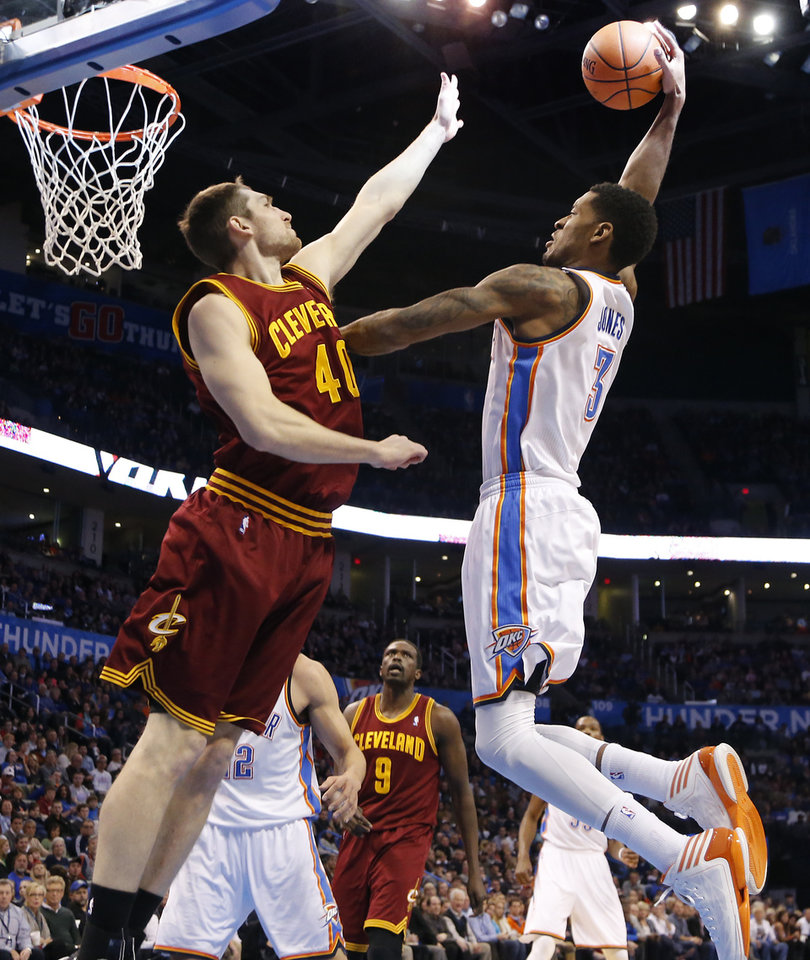Oklahoma City's Perry Jones (3) goes over Cleveland's Tyler Zeller (40) for a shot during the NBA basketball game between the Oklahoma City Thunder and the Cleveland Cavaliers at the Chesapeake Energy Arena in Oklahoma City, Okla. on Wednesday, Feb. 26, 2014. PHOTO BY CHRIS LANDSBERGER, The Oklahoman