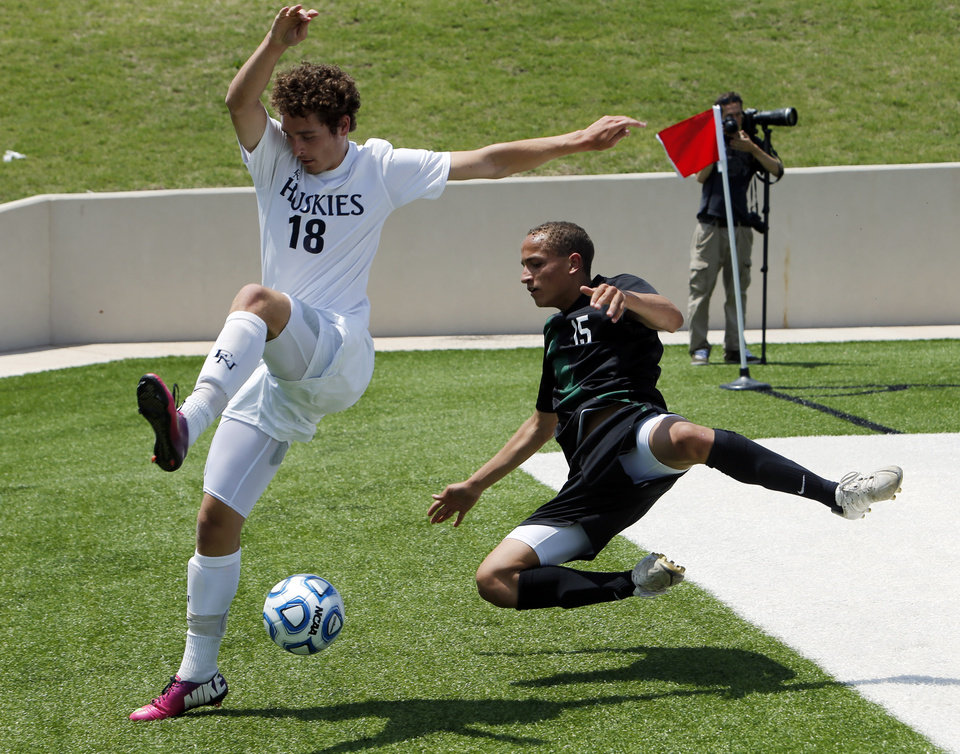 Edmond North's Clay Collier, (18) and Jacob Jerles chase the ball out of bounds in the Class 6A boys state soccer championship game between Edmond North and Norman North on Saturday, May 11, 2013 in Noble, Okla.  Photo by Steve Sisney, The Oklahoman