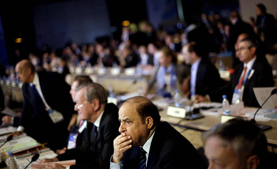 Photo - International Olympic Committee member Samih Moudallal, of Syria, waits for the IOC's general assembly to convene on its first day at the 2014 Winter Olympics, Wednesday, Feb. 5, 2014, in Sochi, Russia. (AP Photo/David Goldman)