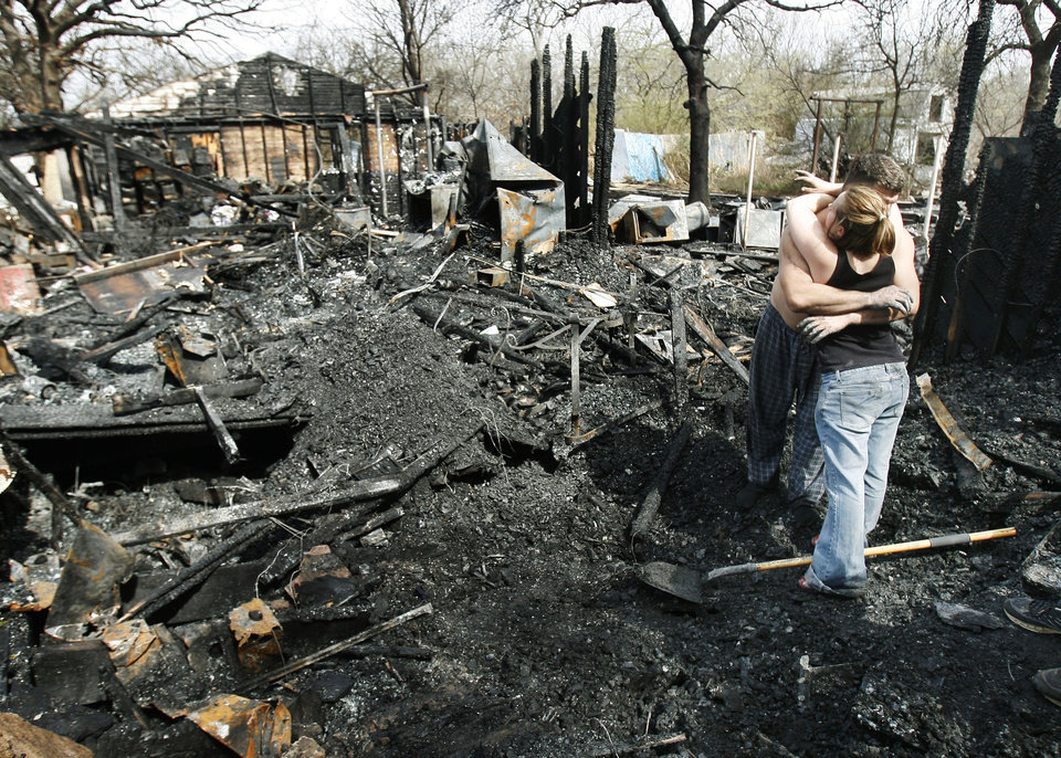 Photo - HOUSE FIRE / DAMAGE: Edmond residents comfort one another as they sift through the ashes of their Edmond, OK, home, Monday, March 9, 2009. The home burned to the ground last night on Covell Lane in east Edmond. BY PAUL HELLSTERN, THE OKLAHOMAN ORG XMIT: KOD