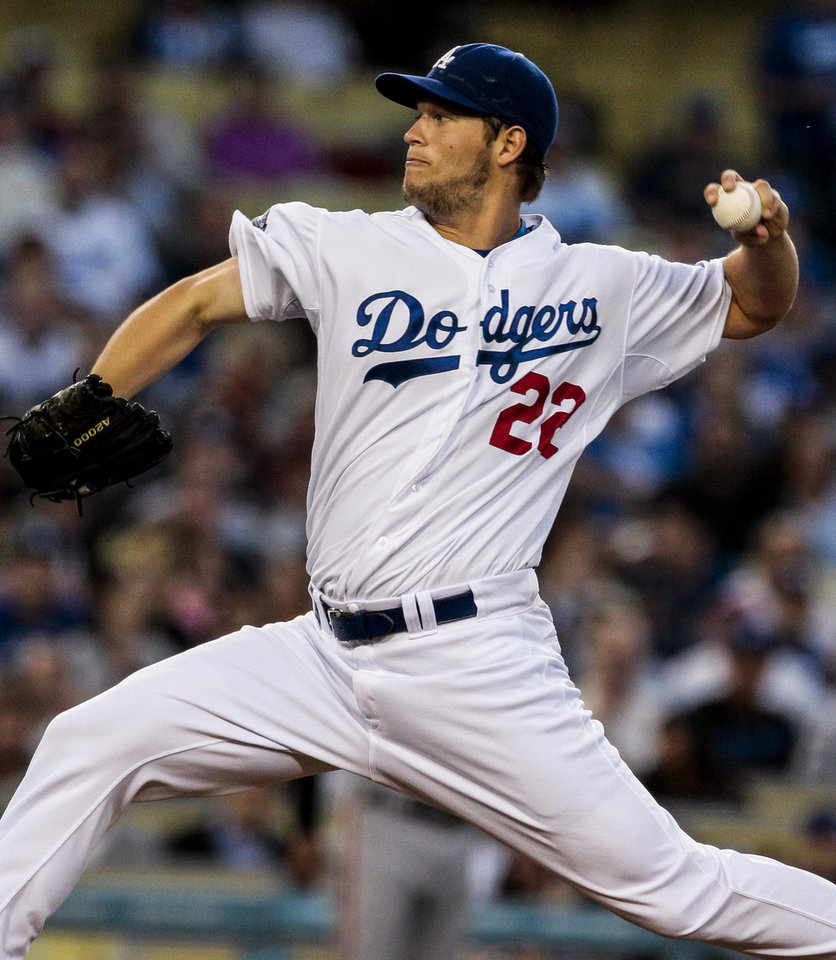 Photo -   Los Angeles Dodgers starting pitcher Clayton Kershaw throws to the plate during the second inning of a National League baseball game against the San Francisco Giants, Tuesday, May 8, 2012, in Los Angeles. (AP Photo/Bret Hartman)