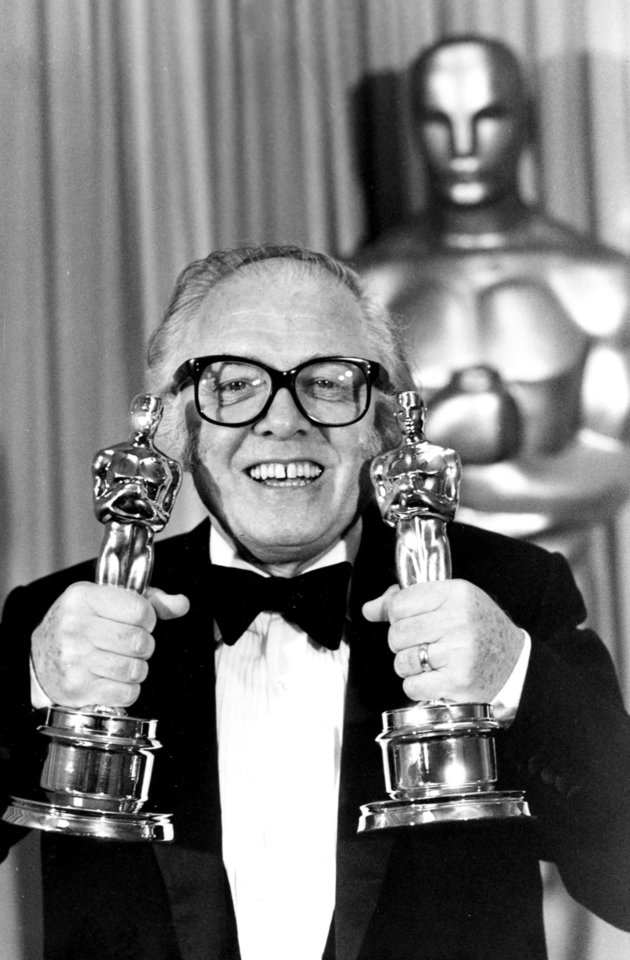 Photo - FILE - In this Monday, April 11, 1983 file photo, British actor and director Richard Attenborough holds his two Oscars for his epic movie