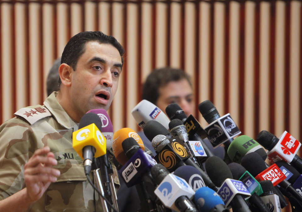 Photo - Egyptian armed forces spokesman Col. Ahmed Mohamed Ali talks during a press conference in Cairo, Egypt, Monday, July 8, 2013. Ali said police and troops guarding the Republican Guard complex came under