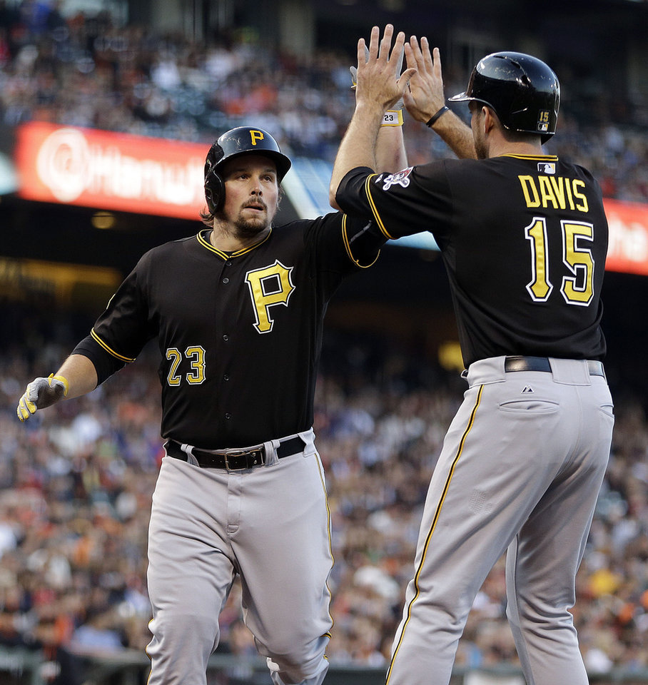 Photo - Pittsburgh Pirates' Travis Snider, left, is congratulated by Ike Davis (15) after Snider hit a two run home run off San Francisco Giants' Tim Hudson in the second inning of a baseball game Tuesday, July 29, 2014, in San Francisco. (AP Photo/Ben Margot)