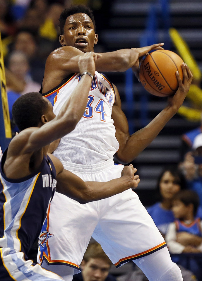 Photo - Oklahoma City's Hasheem Thabeet (34) grabs a rebound in front of Memphis' Tony Allen (9) during an NBA basketball game between the Memphis Grizzlies and the Oklahoma City Thunder at Chesapeake Energy Arena in Oklahoma City, Friday, Feb. 28, 2014. PHOTO BY NATE BILLINGS, The Oklahoman