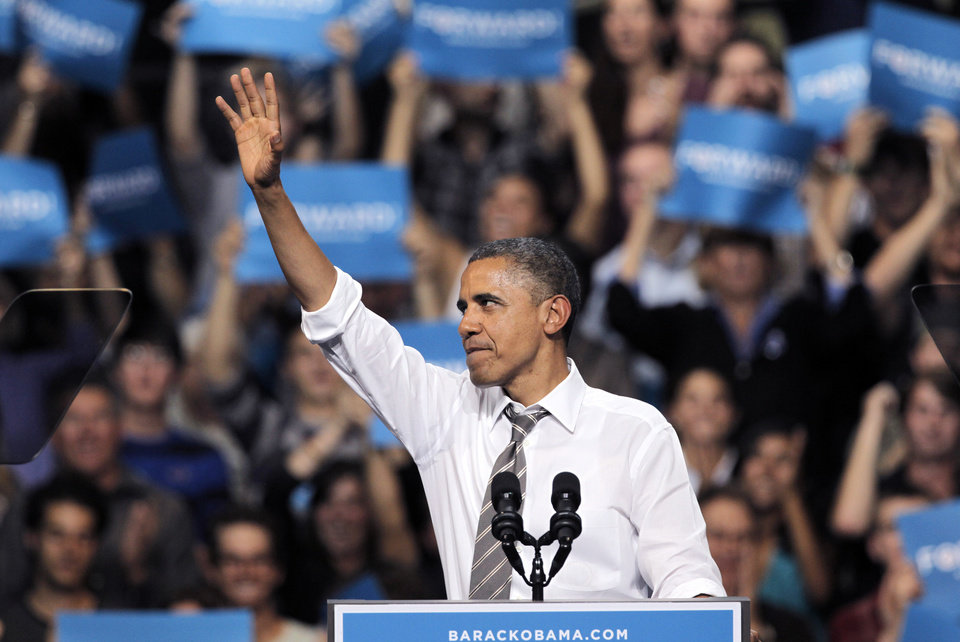 Photo -   President Barack Obama waves after delivering a speech during a campaign rally at the University of Colorado, in Boulder, Colo., Thursday, Nov. 1, 2012. (AP Photo/Brennan Linsley)