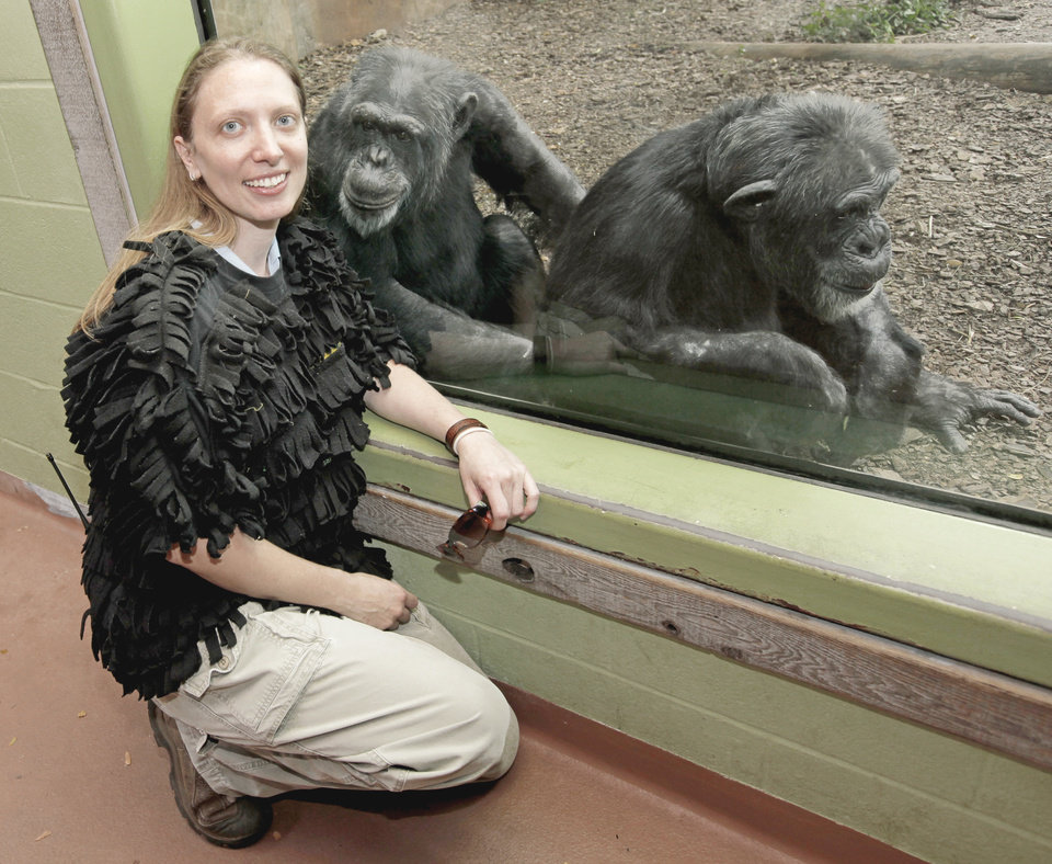 Jennifer Davis, supervisor of great apes wears a shirt made from a T-shirt and pieces of fleece that was used to teach a a baby chimpanzee how to cling to its mother.  PHOTO BY NATE BILLINGS, THE OKLAHOMAN