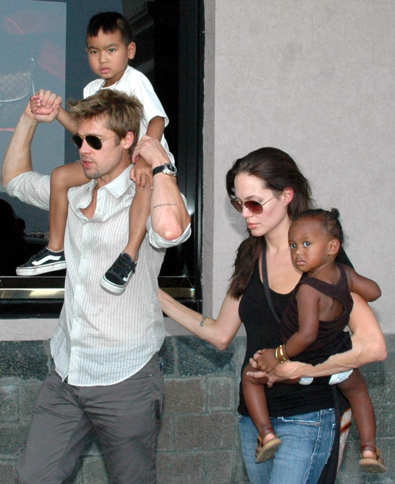 Photo - FILE - In this Nov. 12, 2006, file photo, American movie star and United Nations High Commissioner for Refugees Ambassador Angelina Jolie, right, with her daughter Zahara, and Brad Pitt, left, with Jolie's son Maddox, walk near the Gateway of India in Mumbai, India. Jolie and Pitt were married Saturday, Aug. 23, 2014, in France, according to a spokesman for the couple. (AP Photo/File)