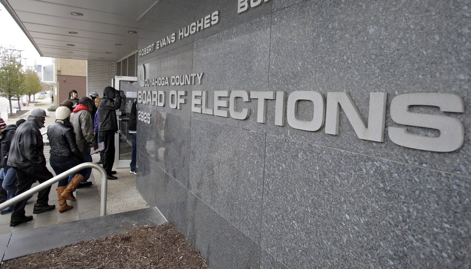 Voters enter the Cuyahoga County Board of Elections in Cleveland on the last day of early voting in Ohio Monday, Nov. 5, 2012. About 1.6 million people have voted early in Ohio. (AP Photo/Mark Duncan)