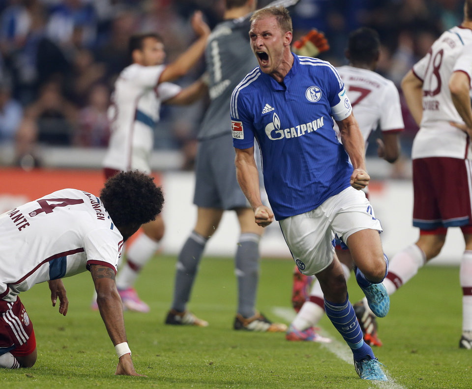 Photo - Schalke's Benedikt Horwedes celebrates after scoring  during the German first division Bundesliga soccer match between Schalke 04  and Bayern Munich in Gelsenkirchen, Germany, Saturday, Aug. 30, 2014. (AP Photo/Frank Augstein)