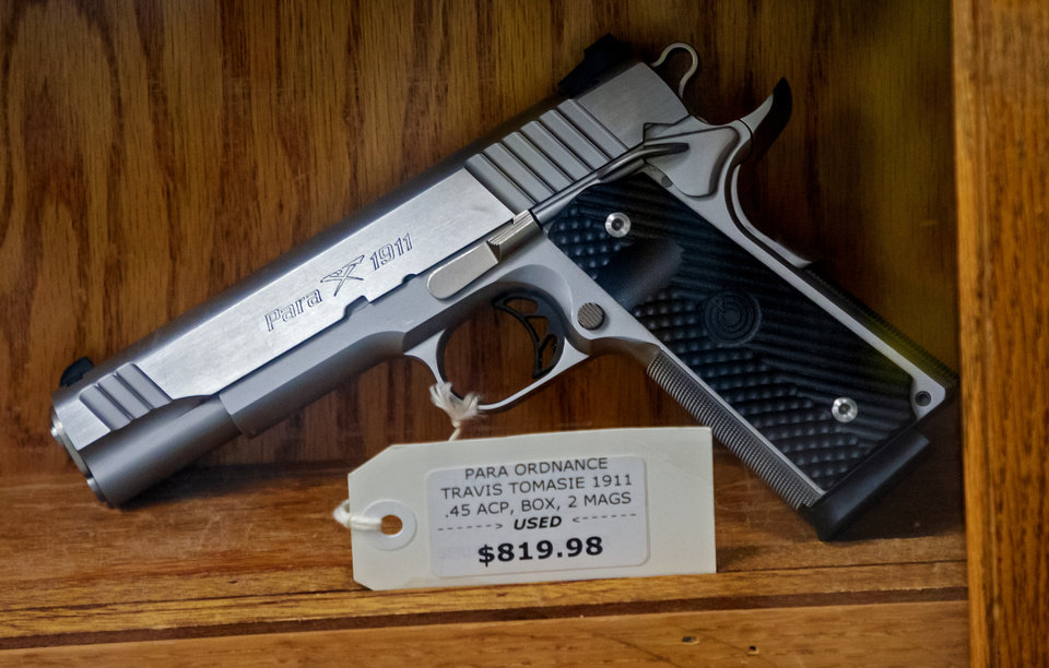 Photo - A handgun for sale at H&H Shooting Sports in Oklahoma City, Okla. on Wednesday, March 18, 2020.  [Chris Landsberger/The Oklahoman]