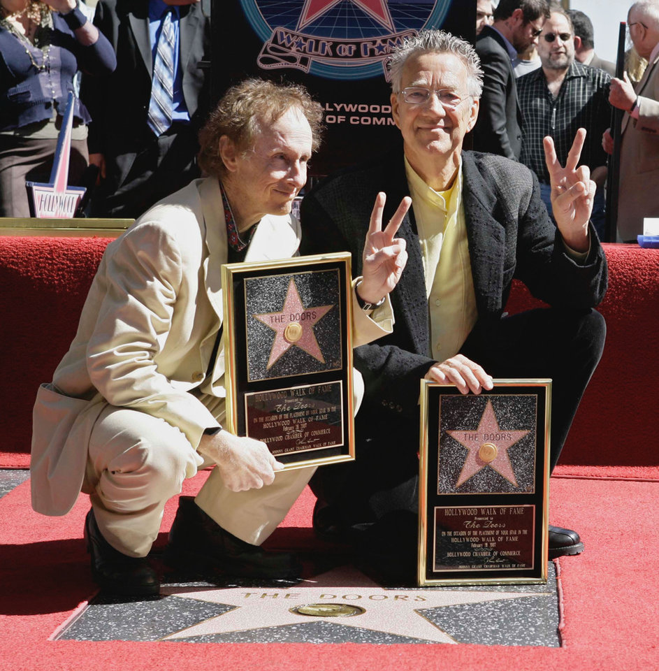 Photo - FILE - In this Feb. 28, 2007 file photo, former Doors band members Ray Manzarek, right, and Robby Krieger display the stars they received on the Walk of Fame in the Hollywood section of Los Angeles. Manzarek, the keyboardist for the Doors has died at 74. Publicist Heidi Robinson-Fitzgerald says in a news release that Manzarek died Monday, May 20, 2013, at the RoMed Clinic in Rosenheim, Germany, surrounded by his family. (AP Photo/Nick Ut, File)