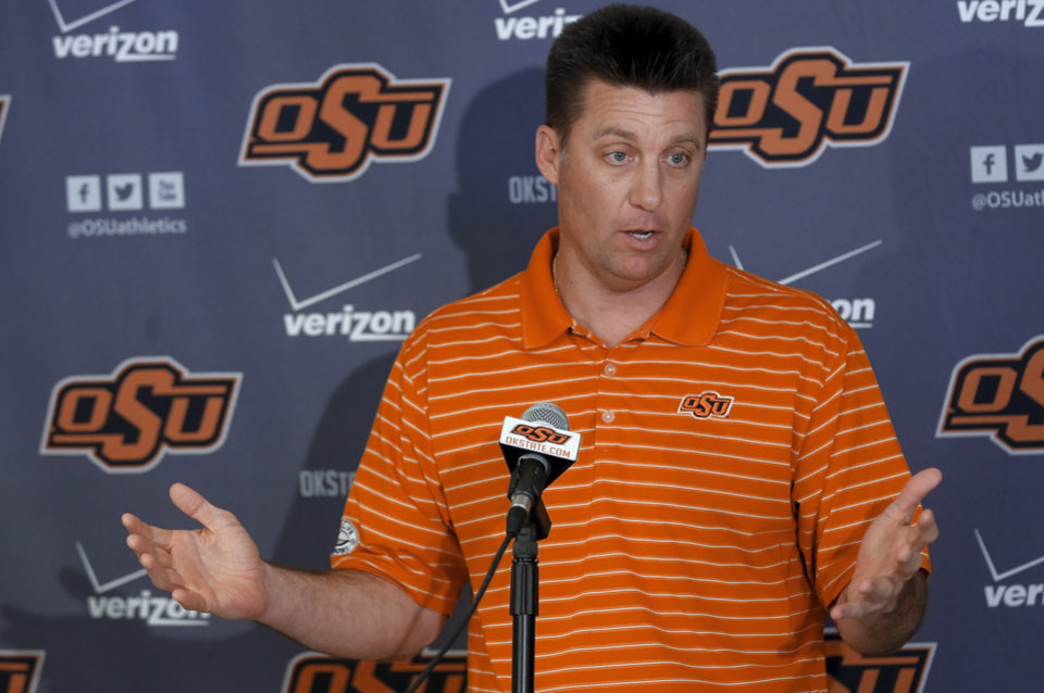Photo - Oklahoma State football coach Mike Gundy speaks during a press conference before the start of spring football practice at Oklahoma State University in Stillwater, Okla., on Monday, March 10, 2014.  Photo by Chris Landsberger, The Oklahoman