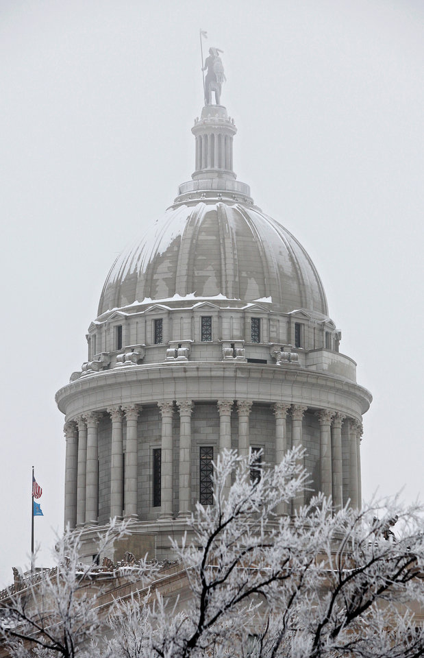 A gray and overcast sky casts a gloomy image of the state capitol as Gov. Brad Henry delivered his yearly State of the State message to a joint session of lawmakers in the House chambers  Monday afternoon, Feb, 1, 2010.  Photo by Jim Beckel, The Oklahoman