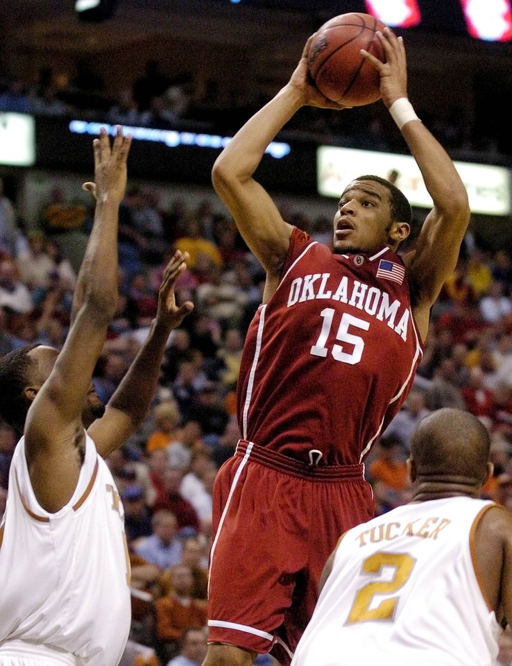 Photo - COLLEGE BASKETBALL: University of Oklahoma against Texas University during the Big 12 tournament at American Airlines Center in Dallas, Texas, Friday, March 12, 2004.  OU's De'Angelo Alexander shoots between Kenny Taylor, left, and P.J. Tucker of Texas during the first half of Oklahoma's loss to Texas. Alexander finished with 15 points. Staff photo by Bryan Terry.