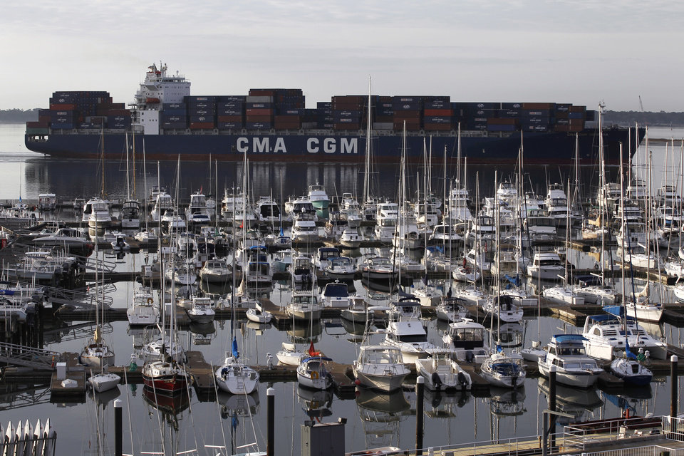 Photo -   FILE - In this Jan. 17, 2012 file photo, the container ship CMA CGM Georgia, sails into Charleston Harbor past a marina in Mount Pleasant, S.C., near Charleston, S.C. The U.S. trade deficit fell in February 2012 to the lowest point in four months because American exports rose to an all-time high while imports dropped. The Commerce Department says the trade deficit decreased 12.4 percent to $46 billion in February, down from $52.5 billion in January. (AP Photo/Matt Rourke, File)