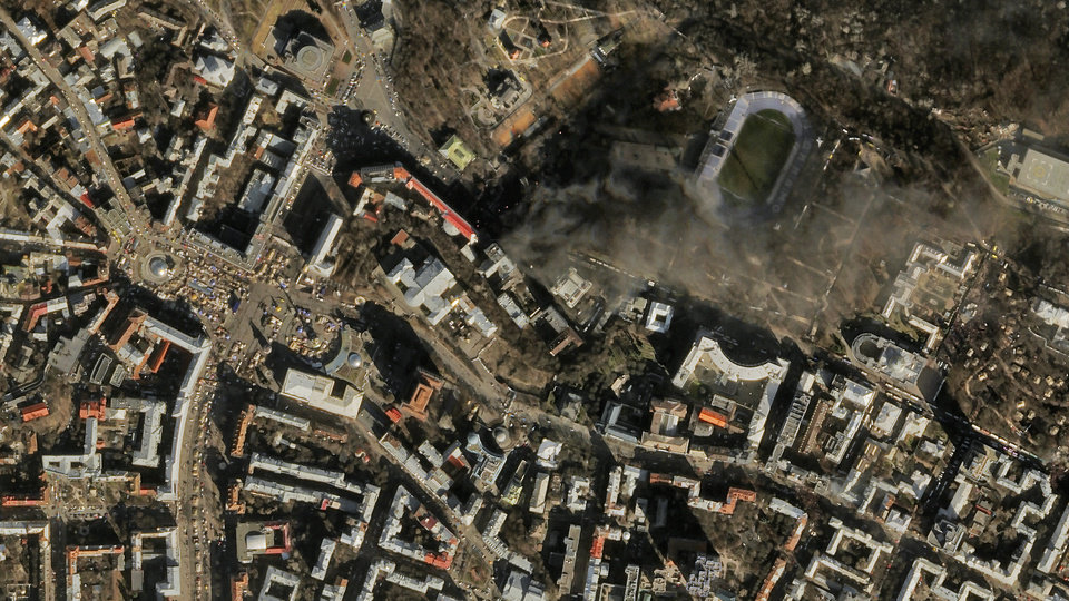 Photo -   In this file satellite image provided by Skybox Imaging and taken by Sky Sat-1 on  Feb. 18, smoke rises from the site of anti-government protests, upper center, in Kiev, Ukraine.  AP Photo   Uncredited -  AP