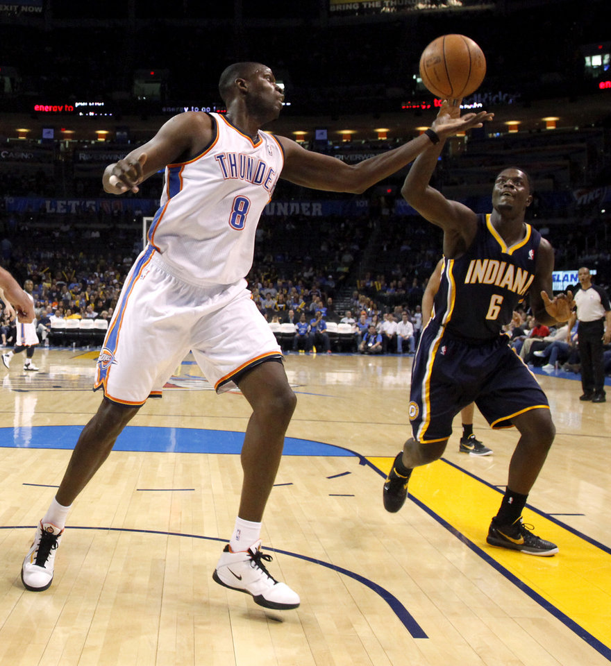 Oklahoma City\'s Nazr Mohammed (8) goes for the ball beside Indiana\'s Lance Stephenson (6) during the NBA basketball game between the Oklahoma City Thunder and the Indiana Pacers at the Oklahoma City Arena, Wednesday, March 2, 2011. Photo by Bryan Terry, The Oklahoman