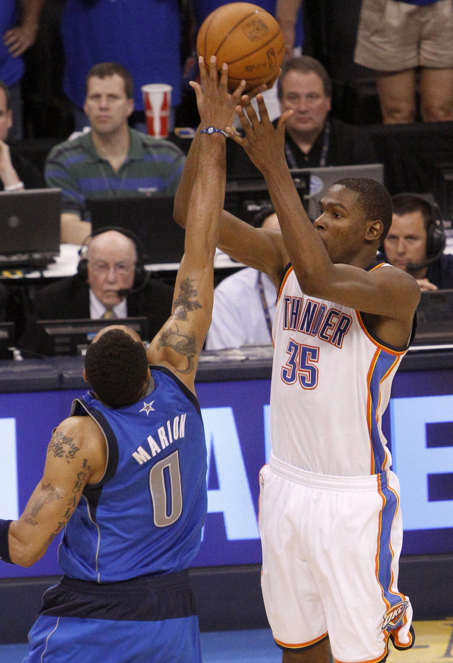 Photo - Oklahoma City's Kevin Durant (35) takes the last shot of regulation over Shawn Marion (0) of Dallas during game 4 of the Western Conference Finals in the NBA basketball playoffs between the Dallas Mavericks and the Oklahoma City Thunder at the Oklahoma City Arena in downtown Oklahoma City, Monday, May 23, 2011. Photo by Bryan Terry, The Oklahoman