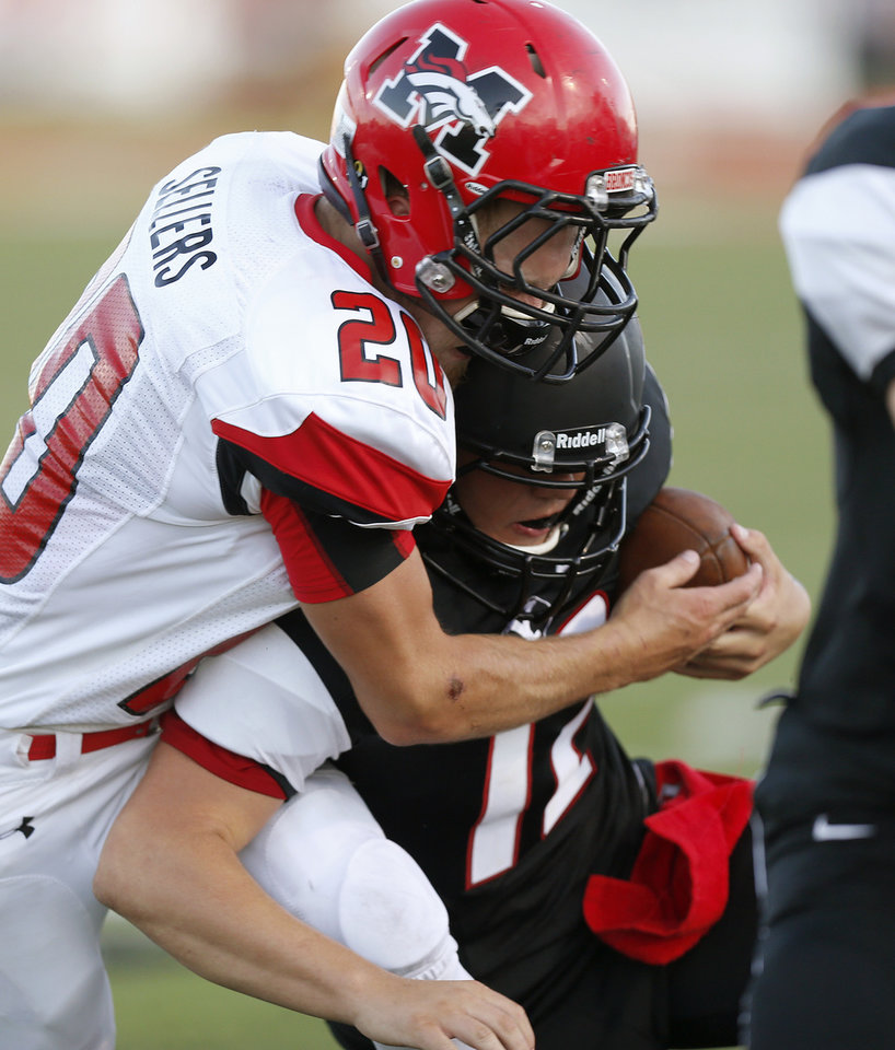 Mustang's Dakota Sellers brings down  Yukon's Hayden Somerville during a high school football game in Yukon, Okla., Friday, August 31, 2012. Photo by Bryan Terry, The Oklahoman