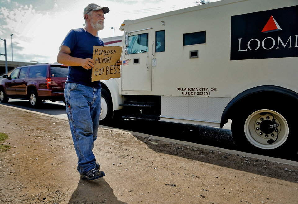 Raymond Hauser, 50, of Joplin, Mo. \'walks the line\' while he panhandles the intersection at I-40 and MacArthur Blvd. on Wednesday, Sept. 26, 2012, in Oklahoma City, Okla. Hauser ended up in Oklahoma after being stranded while hitchhiking to California a month ago. Photo by Chris Landsberger, The Oklahoman