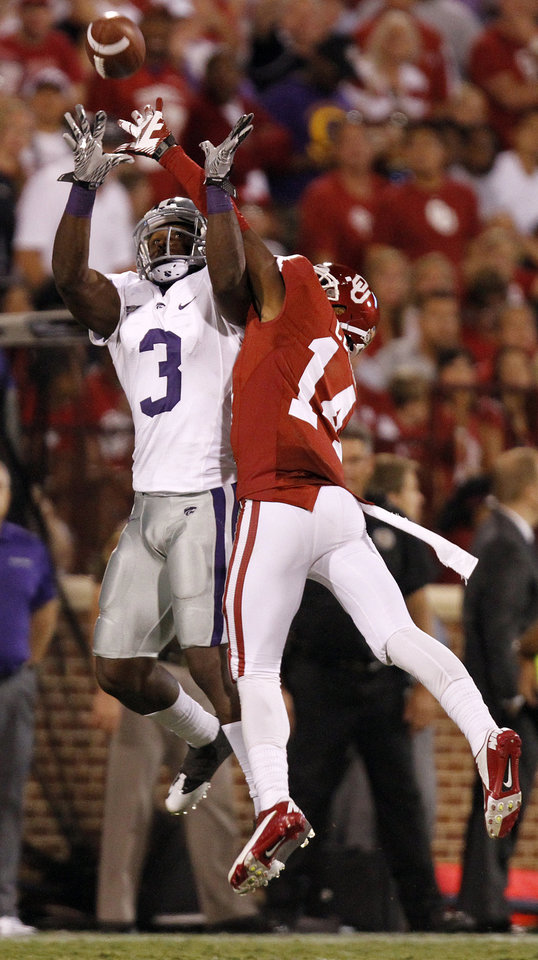 Photo - Oklahoma's Aaron Colvin (14) battles Kansas State's Chris Harper (3) for the ball during the college football game between the University of Oklahoma Sooners (OU) and the Kansas State University Wildcats (KSU) at the Gaylord Family-Memorial Stadium on Saturday, Sept. 22, 2012, in Norman, Okla. Photo by Chris Landsberger, The Oklahoman