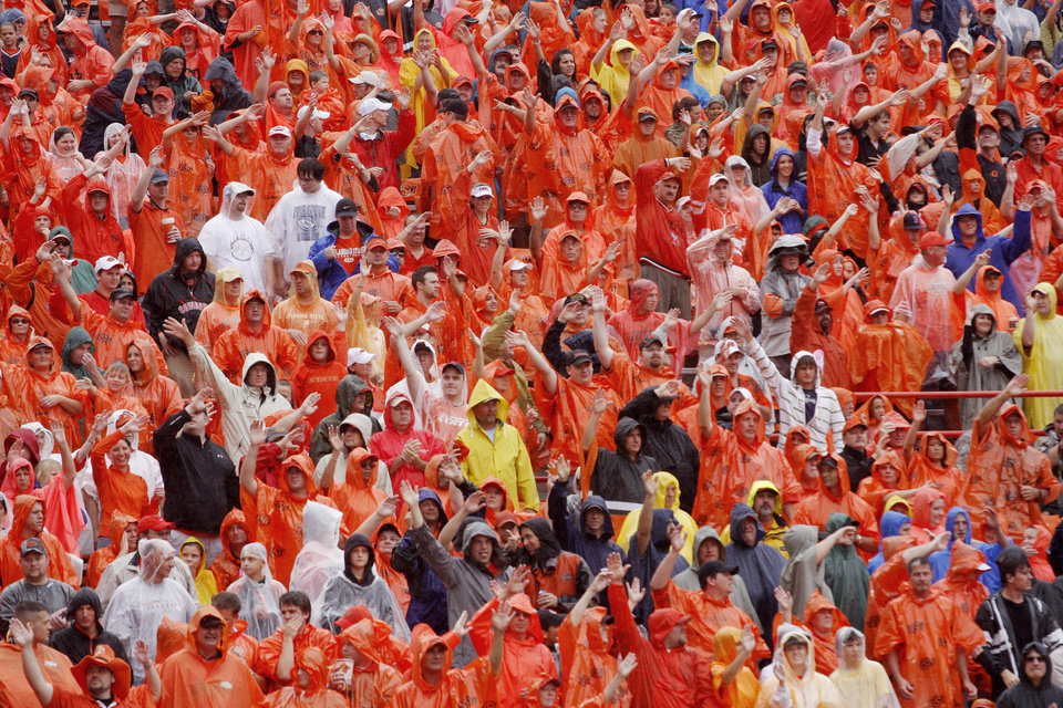 Photo - Poncho clad fans at the Oklahoma State University (OSU) football game against Missouri State University (MSU) Saturday Sept. 13, 2008 at Boone Pickens Stadium in Stillwater, Okla. BY DOUG HOKE, THE OKLAHOMAN.
