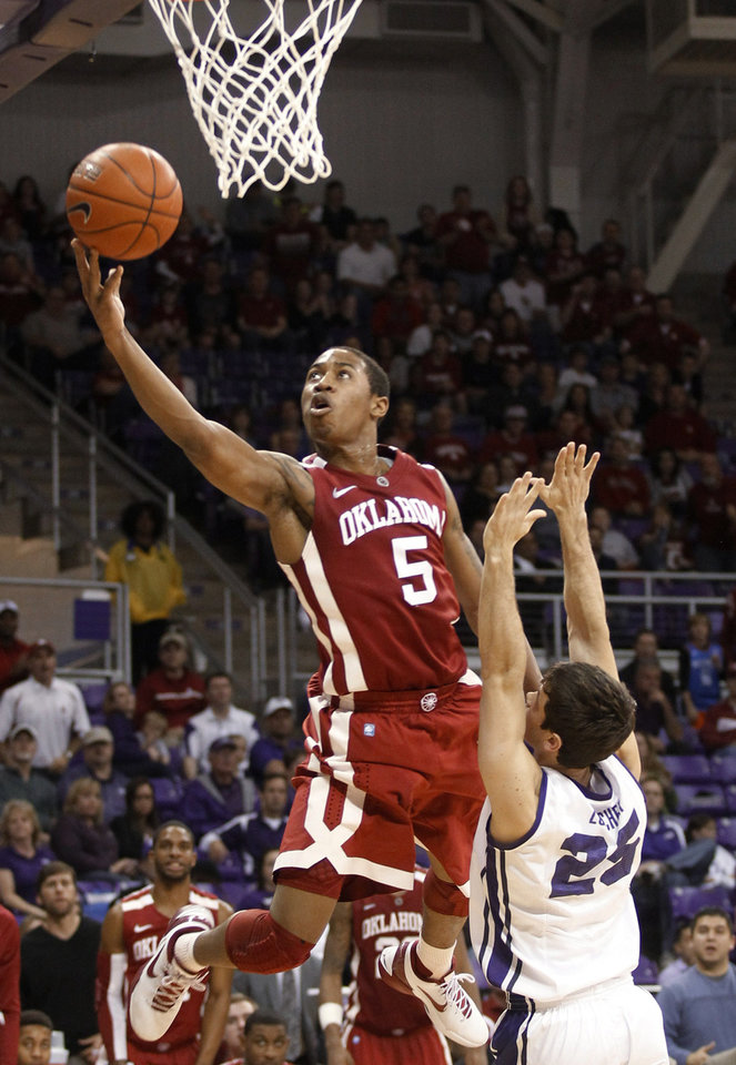 Oklahoma guard Je'lon Hornbeak (5) goes over TCU guard Chris Zurcher (25) for a shot during the second half of an NCAA college basketball game Saturday, March 9, 2013, in Fort Worth, Texas. (AP Photo/Fort Worth Star-Telegram, Rodger Mallison) ORG XMIT: TXFOR403