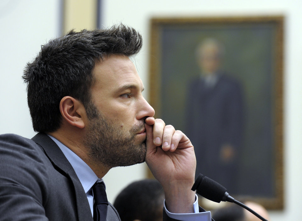 Photo - Ben Affleck, actor and founder of the Eastern Congo Initiative, listens to testimony during the House Armed Services Committee hearing on the evolving security situation in the Democratic Republic of the Congo on Capitol Hill in Washington, Wednesday, Dec. 19, 2012. (AP Photo/Susan Walsh)