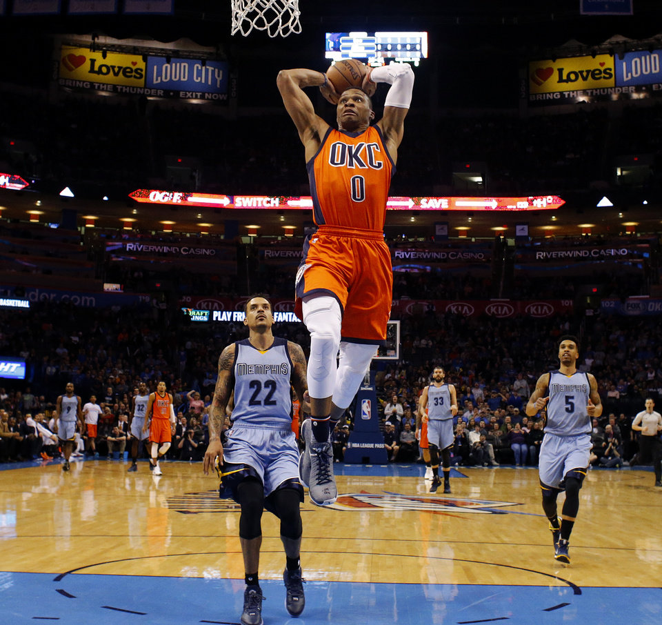 Photo - Oklahoma City's Russell Westbrook (0) goes up for a dunk as Memphis' Matt Barnes (22) and Courtney Lee (5) watch during an NBA basketball game between the Oklahoma City Thunder and the Memphis Grizzlies at Chesapeake Energy Arena in Oklahoma City, Wednesday, Jan. 6, 2016.  Photo by Bryan Terry, The Oklahoman