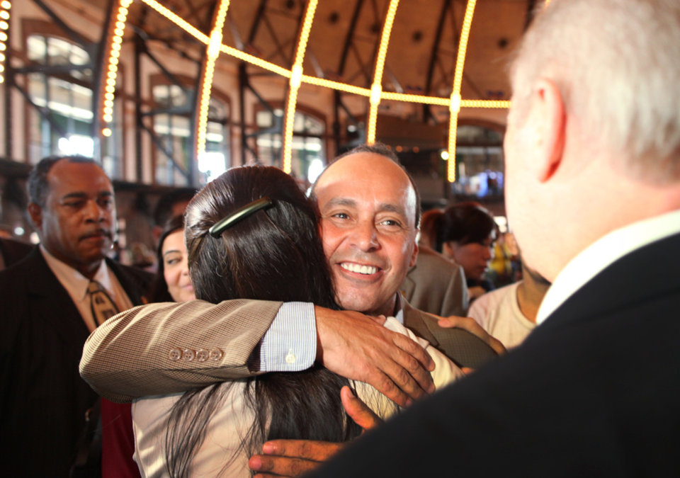 Photo -   Rep. Luis Gutierrez (D-IL) hugs Tereza Lee, who came to the United States illegally at the age of two but is now a U.S. citizen, at an event marking the start of start of the Obama administration's Deferred Action for Childhood Arrivals program on Wednesday, Aug. 15, 2012 at Navy Pier in Chicago. (AP Photo/Sitthixay Ditthavong)