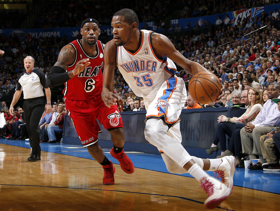 Oklahoma City\'s Kevin Durant (35) goes past Miami\'s LeBron James (6) during an NBA basketball game between the Oklahoma City Thunder and the Miami Heat at Chesapeake Energy Arena in Oklahoma City, Thursday, Feb. 15, 2013. Photo by Bryan Terry, The Oklahoman