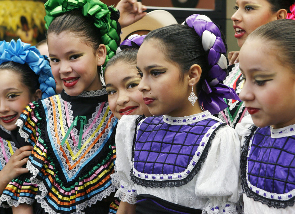 Folkloric dancers from Columbus Elementary School smile for photos before their performance at the opening celebration for the new offices of the Hispanic Chamber of Commerce on SW 59th and Walker in Oklahoma City, OK, Friday, Jan. 30, 2009. BY PAUL HELLSTERN, THE OKLAHOMAN