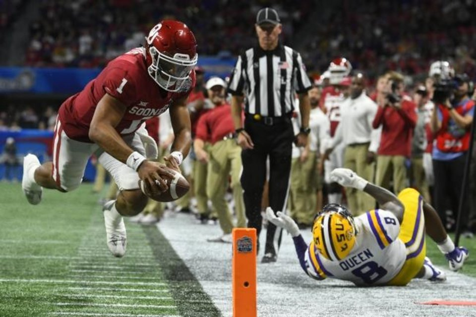 Photo -  In one of the few highlights for OU on Saturday, quarterback Jalen Hurts (1) dives to the pylon to score a touchdown in the second half of a 63-28 loss to LSU in the Peach Bowl in Atlanta. [AP Photo/John Amis]