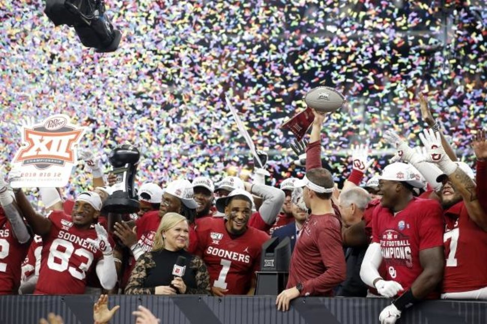 Photo -  Oklahoma coach Lincoln Riley hoists the Big 12 championship trophy after beating Baylor 30-23 in overtime Saturday. [Bryan Terry/The Oklahoman]