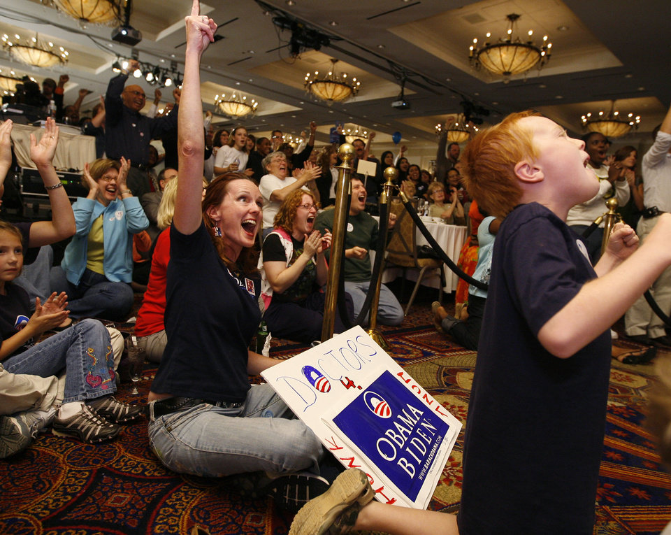Photo - Libby Albert, left, and Luke Albert, 9, of Oklahoma City celebrate during the Democratic watch party for the presidential election in Oklahoma City, Tuesday, November 4, 2008. BY BRYAN TERRY, THE OKLAHOMAN