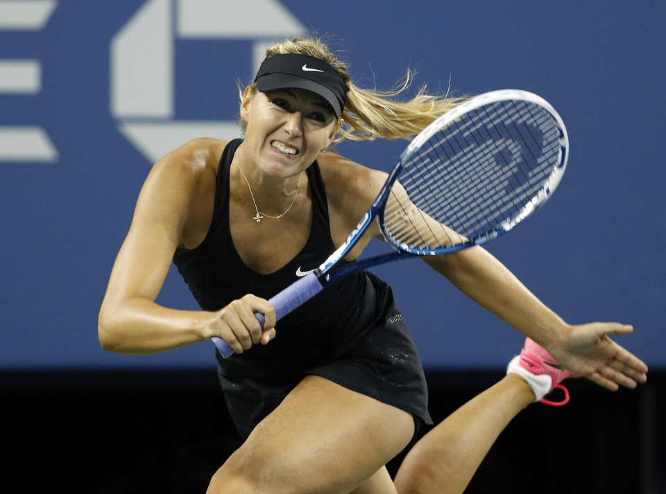 Photo - Maria Sharapova, of Russia, watches a return to Sabine Lisicki, of Germany, during the third round of the U.S. Open tennis tournament Friday, Aug. 29, 2014, in New York. (AP Photo/Jason DeCrow)