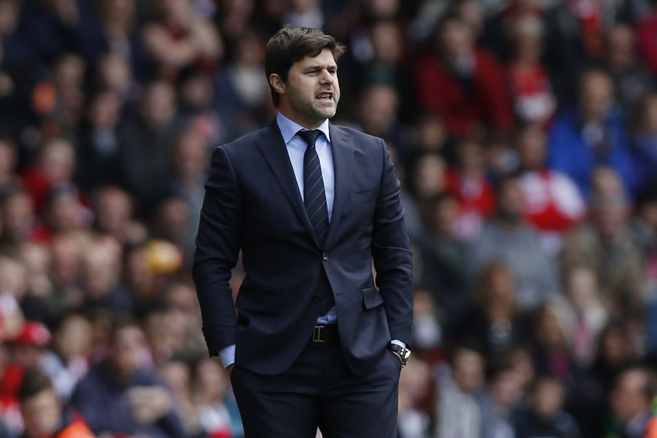 Photo - FILE - In this Sunday, May 11, 2014, file photo, Southampton's manager Mauricio Pochettino watches his team play against Manchester United during their English Premier League soccer match at St Mary's stadium, Southampton, England.  Tottenham has hired Mauricio Pochettino as the club's new manager on a five-year contract, with the former Argentina defender making the move from fellow Premier League side Southampton. (AP Photo/Sang Tan, File)