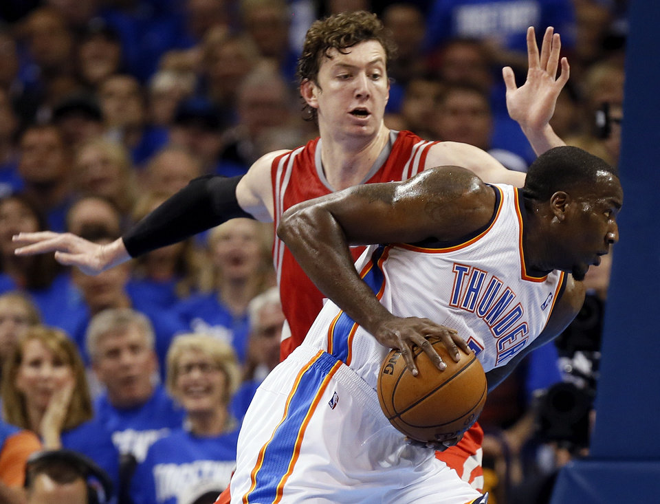 Oklahoma City\'s Kendrick Perkins (5) moves past Houston\'s Omer Asik (3) during Game 1 in the first round of the NBA playoffs between the Oklahoma City Thunder and the Houston Rockets at Chesapeake Energy Arena in Oklahoma City, Sunday, April 21, 2013. Photo by Nate Billings, The Oklahoman
