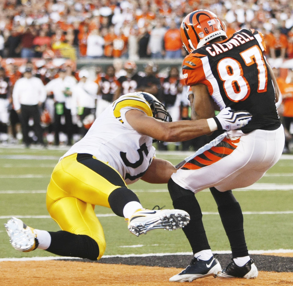 Photo - Cincinnati receiver Andre Caldwell (87) catches the game-winning touchdown against Pittsburgh linebacker James Farrior (51) in the closing seconds of the fourth quarter Sunday. AP PHOTO