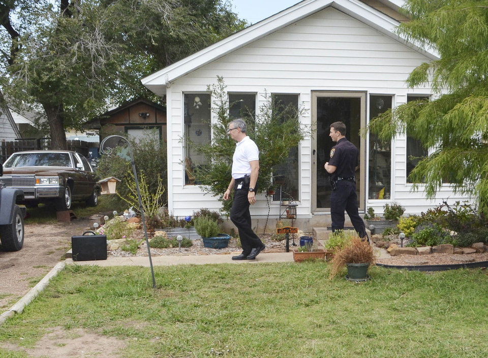 Norman police officers search a house Wednesday afternoon. Police searched the house while investigating a shooting that happened near the residence Tuesday night. Photo by Andrew Knittle, The Oklahoman