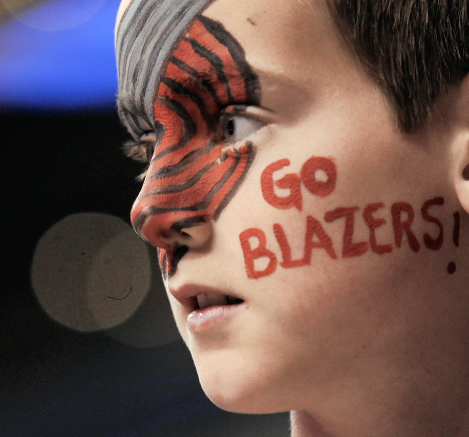 Trail Blazers fan Kyle Stewart, 11, watches the Blazers warm up before an April game. Portland, like Utah and Oklahoma City, has only one major league sports team. AP Photo