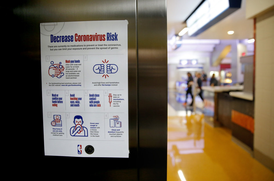 Photo - A sign inside an elevator that lists ways to help decrease the risk of exposure and spread of the coronavirus is seen before an NBA basketball game between the Oklahoma City Thunder and the Utah Jazz at Chesapeake Energy Arena in Oklahoma City, Wednesday, March 11, 2020. [Bryan Terry/The Oklahoman]
