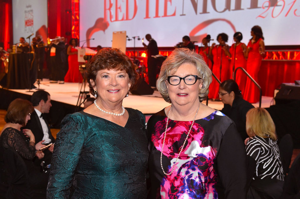 Photo -  The 23rd Annual Red Tie Night benefiting the Oklahoma AIDS Care Fund was March 7 at the Cox Convention Center. Co-chairwomen Karen Browne, left, and Mary Streich arrive at the event, which is the single largest evening fundraiser in Oklahoma. Photo provided
