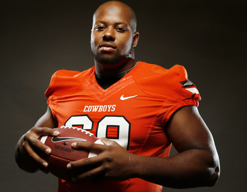 COLLEGE FOOTBALL: Devin Davis (69) poses for a photo during media day for the Oklahoma State University football team inside OSU\'s Gallagher-Iba Arena, Saturday, Aug. 3, 2013. Photo by Nate Billings, The Oklahoman