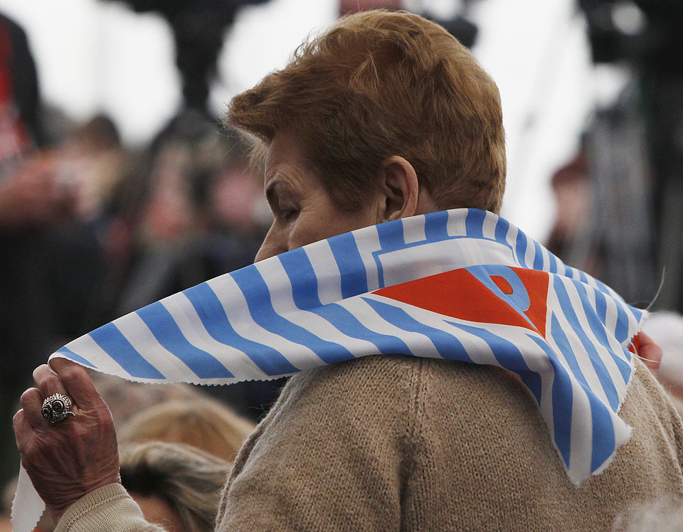 Photo - A former prisoner  attends a ceremony at  the Auschwitz concentration camp  in Oswiecim, Poland, Sunday, Jan. 27, 2013,  marking the 68th anniversary of the liberation of Auschwitz by Soviet troops and  remembering  the victims of the Holocaust, in Auschwitz-Birkenau.  (AP Photo/Czarek Sokolowski)